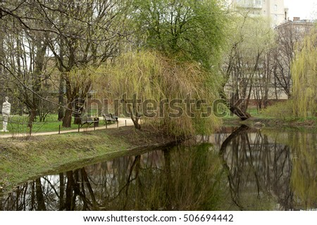 View to a pond with wooden rails