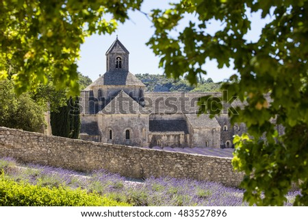 view to abbey through leaves in France