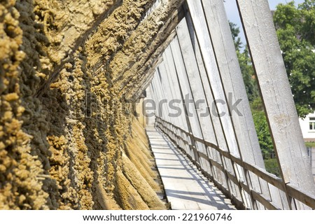 View to an historical graduation tower in Bad Duerrenberg, Saxony-Anhalt. This is a medical-physical structure used salt which removes water. Water drops are moving over the wall.  - stock photo