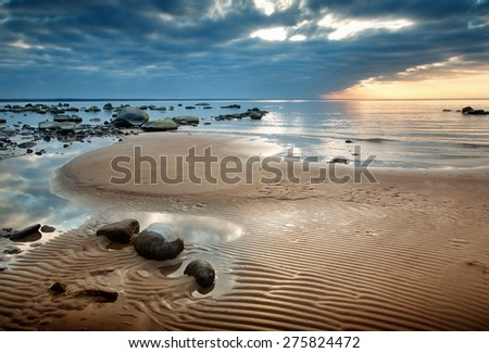 view to baltic seacoast at sunset ligt - stock photo