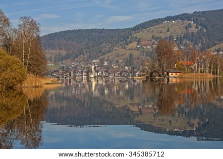 view to bavarian lake schliersee in autumn, water reflection - stock photo