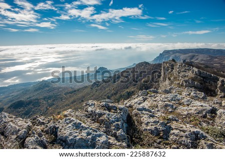 View to Black sea and cloud sea from Ai-Petri mountains at south coast of Crimea peninsula, Russia, in bright and clean autumn day - stock photo