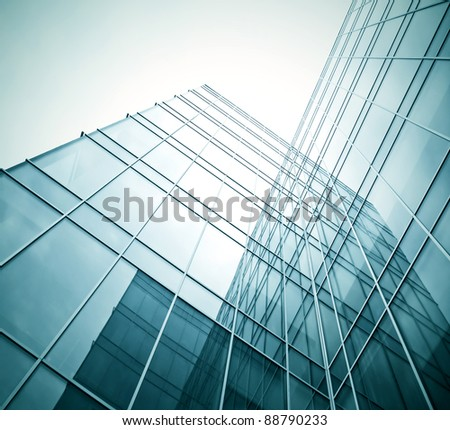 view to dark high rise glass skyscrapers at night - stock photo