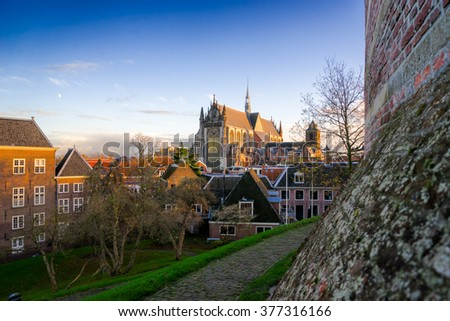 View to Hoodlandse Gothic Cathedral from Burcht van Leiden at evening low angle light and blue sky
