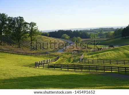 view to horse farm on a hot humid evening in the country - stock photo