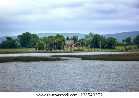 View to Irish house on River Shannon - stock photo