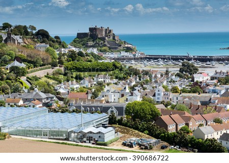 View to Mont Orgueil Castle with harbour in Gorey, Jersey, UK