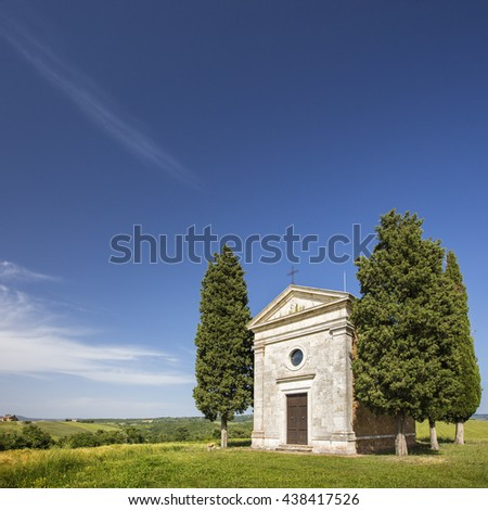 view to old chapel under sky in Tuscany in Italy - stock photo