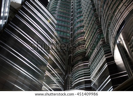 view to steel background of  high rise building skyscrapers in modern futuristic downtown. Business concept of successful industrial architecture - stock photo
