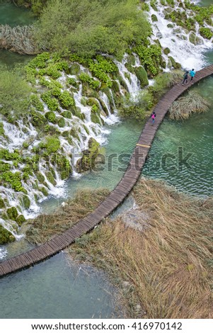 View to the boardwalk at Plitvice Lakes (Croatia). In 1979 the Plitvice Lakes National Park was declared as an UNESCO World Natural Heritage site. The landscape looks like a green paradise.