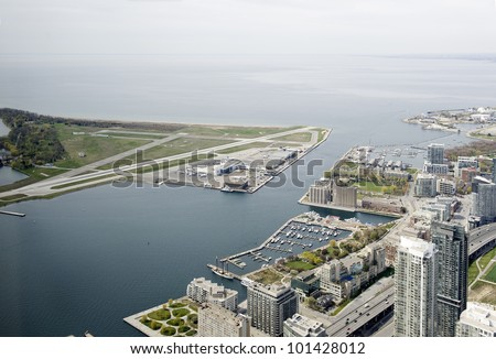 view to the city and airport from the cn tower in toronto - stock photo