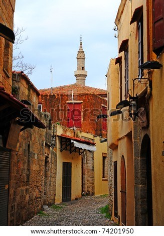 View to the Minaret from the Old Narrow Street of the Greek City of Rhodes