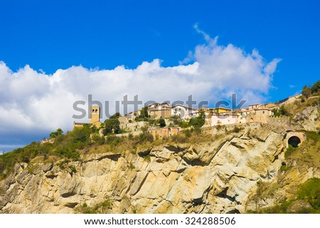 View to the old buildings of San Leo medieval town in San Leo (Rimini), Italy. - stock photo