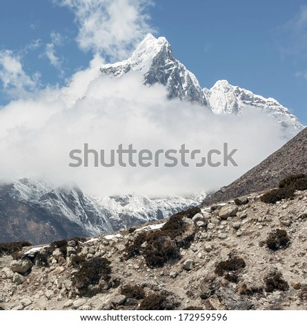 View to the peak Tabuche from the village of Dingboche in the valley of Chhukhung district Everest - Nepal, Himalayas - stock photo
