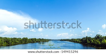view to the river Missisippi with its wide river bed and untouched nature in Louisiana - stock photo