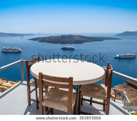 View to the sea and Volcano from restaurant in Fira the capital of Santorini island in Greece - stock photo