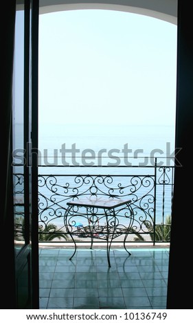 View to the sea from a balcony of hotel. Italy