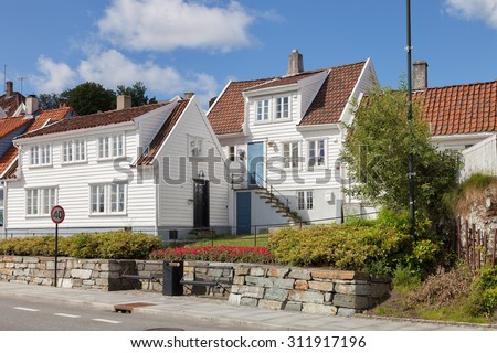 View to the traditional Norwegian white wooden houses in Stavanger, Norway.