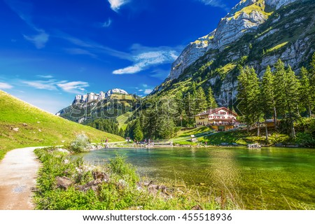 View to tourquise clear Seealpsee with the Swiss Alps (mountain Santis) in the background, Appenzeller Land, Switzerland