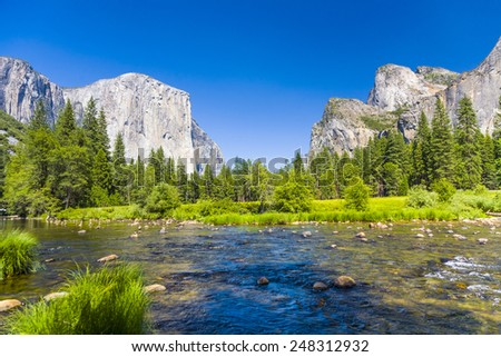 view to western rocket plateau of yosemite national park seen from beautiful Merced river - stock photo