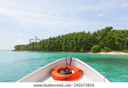 View to Zapatilla island from the bow of the boat, Panama (focus on the island) - stock photo