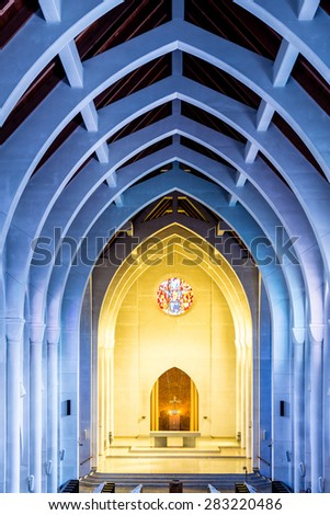 View toward the altar in a church with arched ceiling - stock photo