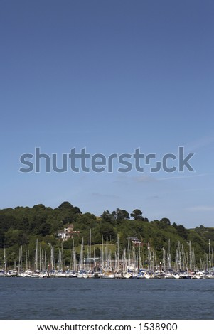 view towards kingswear marina with the rolling devon hills as the background dartmouth devon england europe uk taken in july 2006 - stock photo