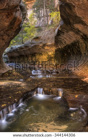View upstream of cascading pools in the unique Subway cavern carved by the Left Fork of North Creek in Zion National Park, Utah. - stock photo