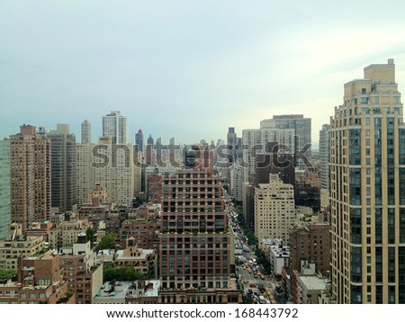 View uptown in the East Midtown area of Manhattan among condo towers in New York, NY, USA. - stock photo
