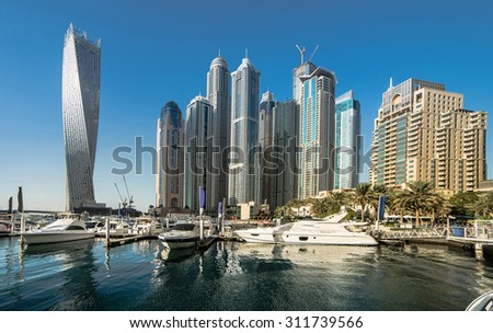 view with modern skyscrapers and water channel of Dubai Marina, United Arab Emirates