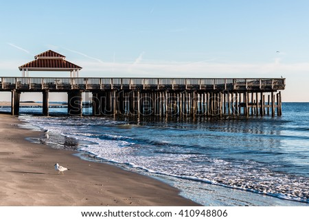 Viewing pier and gazebo at Buckroe Beach in Hampton, Virginia.  - stock photo