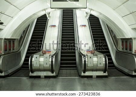 Viewpoint of the base of escalators at a public transportation station - stock photo
