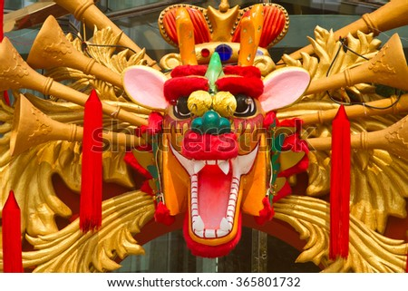 Views of a shopping centre in Thailand with a figure of a dragon