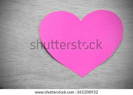 Vignette Style, Series of Valentines Card. Pink heart paper cut on wooden background. Image of Valentines day. Photoshop Vintage Effect. Selective Color. - stock photo