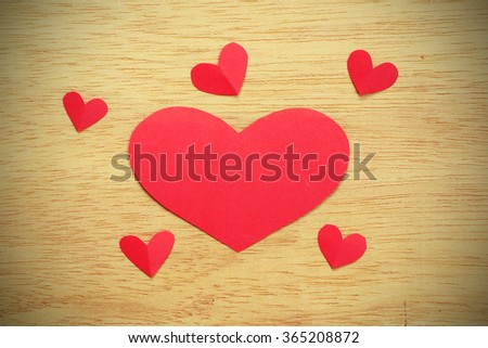 Vignette Style, Series of Valentines Card. Six Red heart paper cut on wooden background. Image of Valentines day. Photoshop Vintage Effect. - stock photo