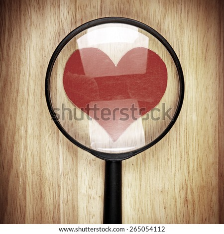 Vignetting Photo of Heart Shape in the Magnifying Glass - stock photo