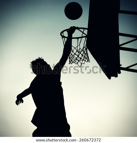 Vignetting Photo of the Silhouette a Basketball Player - stock photo