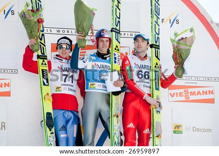 VIKERSUND, NORWAY - MARCH 15: Winners podium at the FIS World Cup Ski Jumping Competition. 1st: Gregor Schlierenzauer (Austria), 2nd: Simon Ammann (Switzerland), 3rd: Dimitry Vassiliev (Russia)