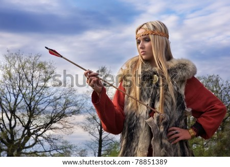 Viking girl warrior with the arrow on a sky backround - stock photo