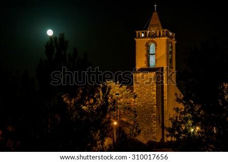 vilafant bell tower under the moonlight girona spain - stock photo
