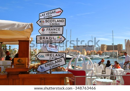Vilamoura, Algarve, Portugal - October 26, 2015: Sports bar with direction, distance, position and indication sign - stock photo