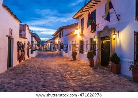 VILLA DE LEYVA, COLOMBIA - SEPTEMBER 21, 2015: Evening moody view of a cobbled street in colonial town Villa de Leyva, Colombia.