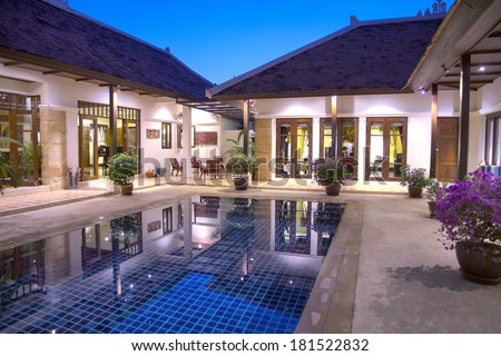Villa in Phuket with swimming pool early evening - stock photo