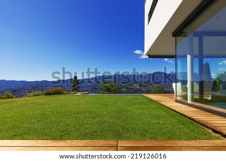 Villa, infinity swimming pool in the garden - stock photo