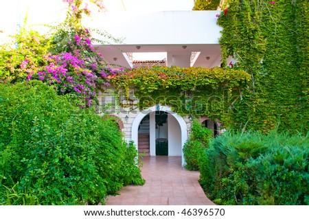 villa on luxury balinese resort with beautiful garden - stock photo