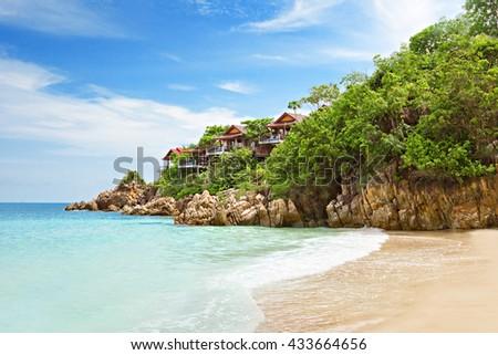 Villa Resort houses on the rock near the beauty beach - stock photo