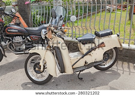 "VILLA ROTTA, FORLI, ITALY - MAY 1: old italian scooter Moto Guzzi Galletto, in rally of classic cars and motorcycles during the feast ""Villarottainfesta"" on May 1, 2015 in Villa Rotta, Forli, Italy"