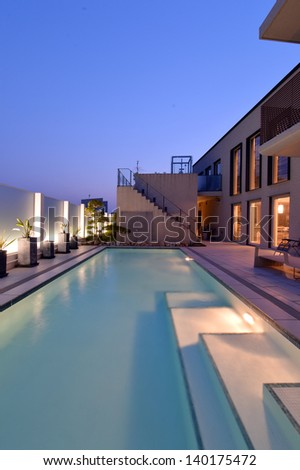 Villa with swimming pool night view-2 - stock photo