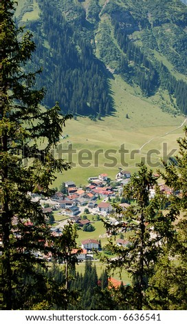 village by the mountain - stock photo