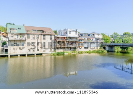village by the riverside - stock photo